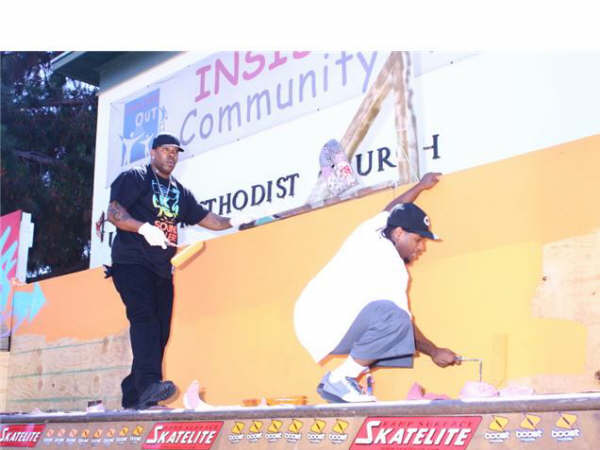 lil eazy and busta rhymes painting boost mobile event.jpg